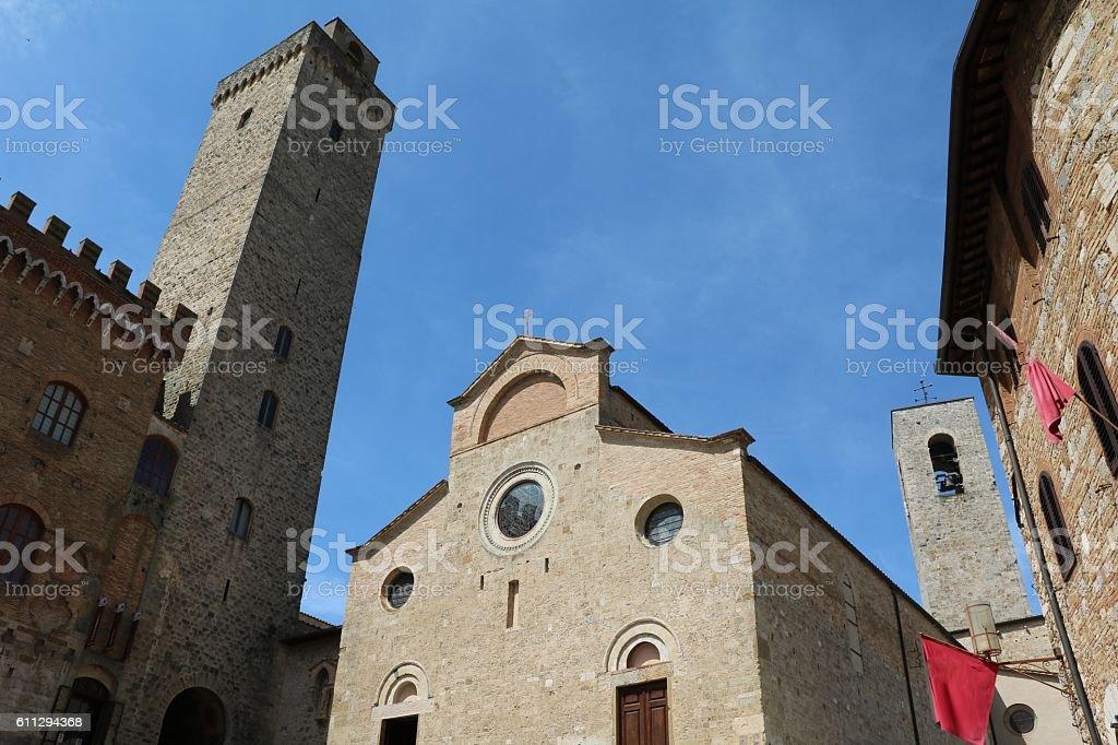 Torre Grossa and Basilika Santa Maria Assunta,  San Gimignano Italy stock photo