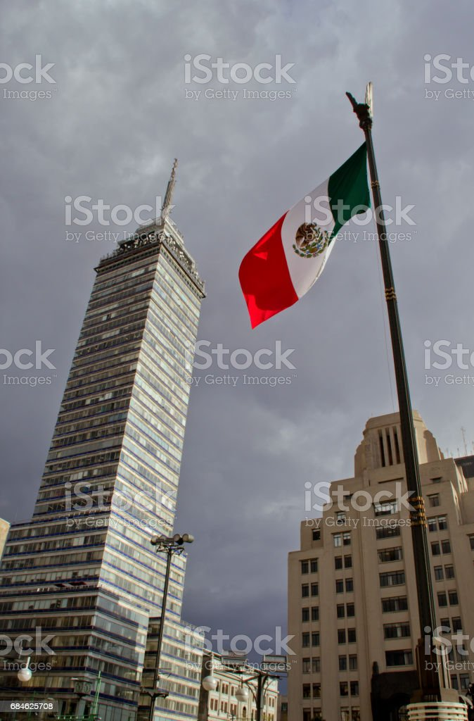 'Torre Latinoamericana' and mexican flag stock photo
