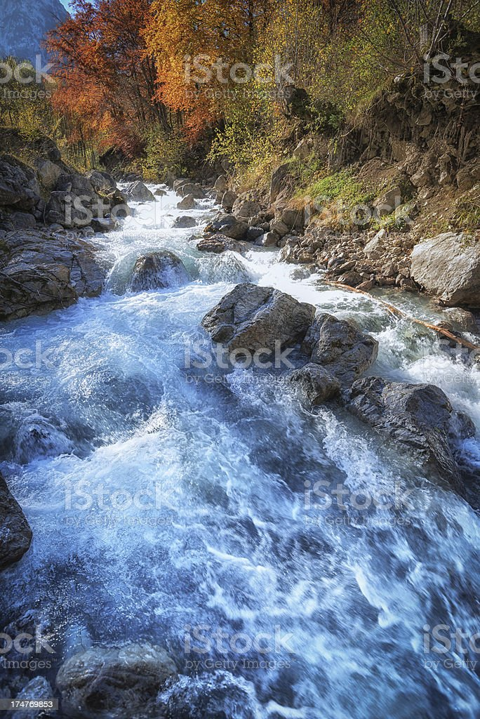 torrent stream in Swiss alpine mountains at autumg stock photo