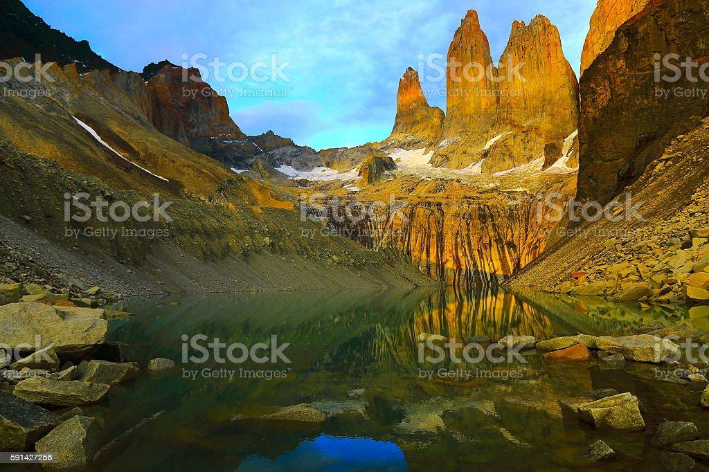 Torres Del Paine Granites, bright sunrise, mirrored lake, Chilean Patagonia stock photo