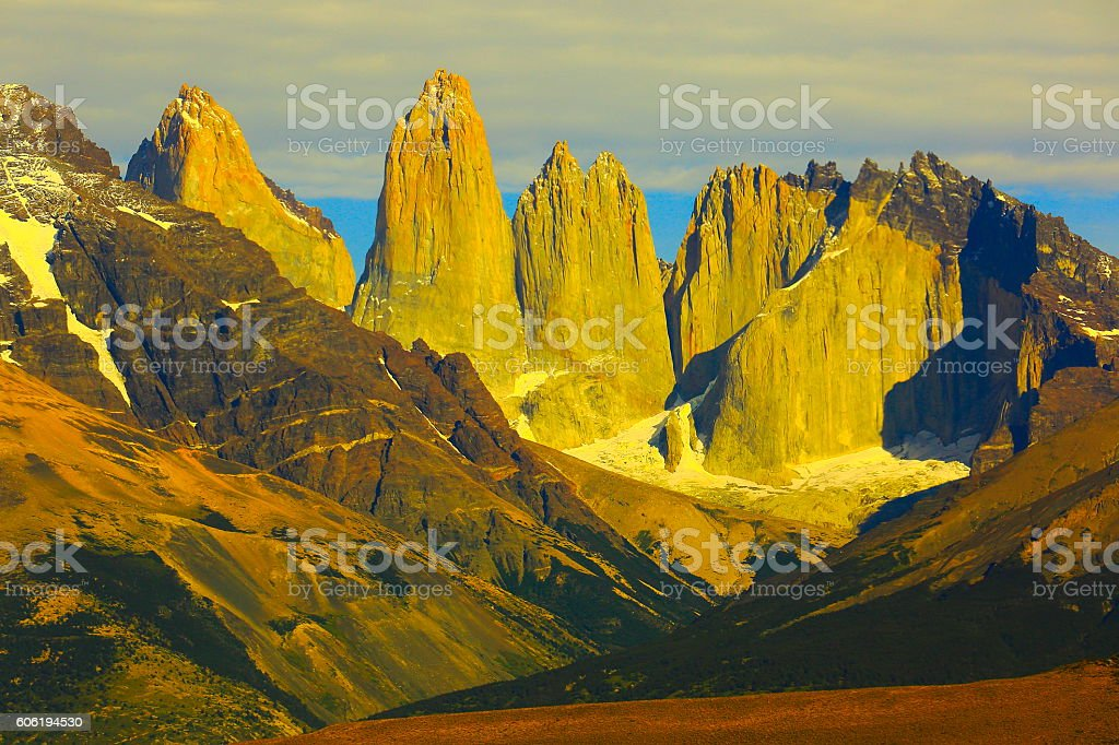 Torres Del Paine Granites over steppe, gold sunset, Chilean Patagonia stock photo