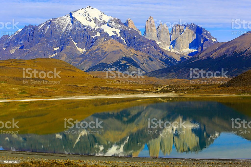 Torres Del Paine Granites over steppe, mirrored lake, Chilean Patagonia stock photo