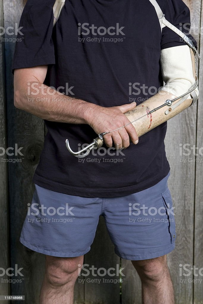 Torso of a man holding his prosthetic arm. royalty-free stock photo