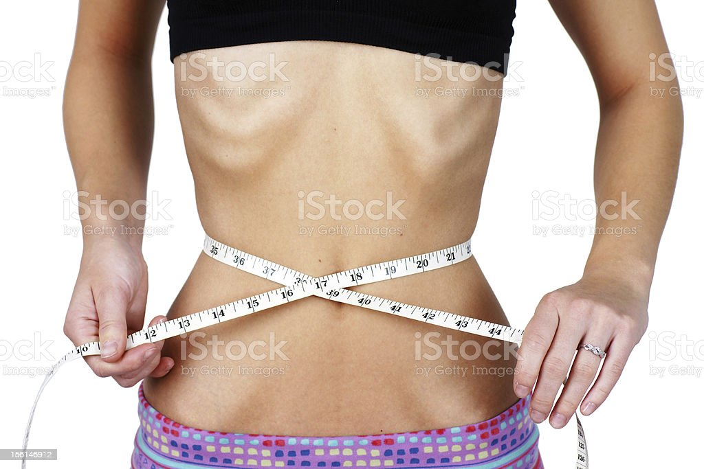 Torso of anorexic young woman stock photo