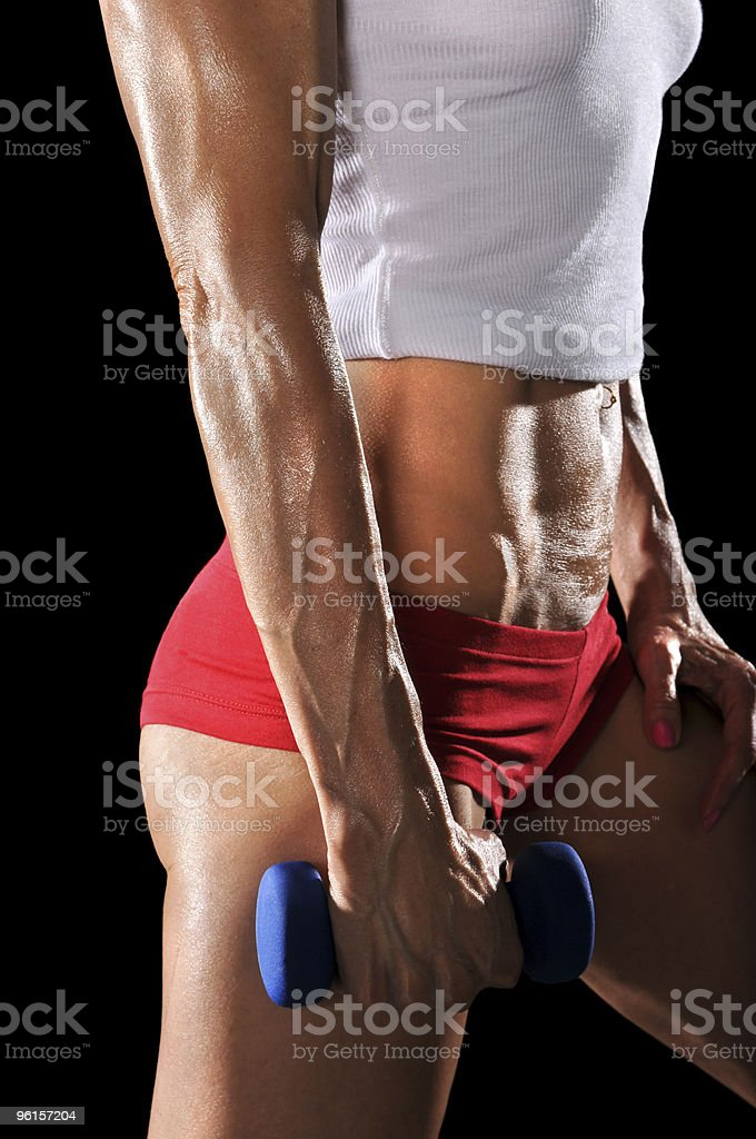 Torso of Female Holding Dumbbell stock photo