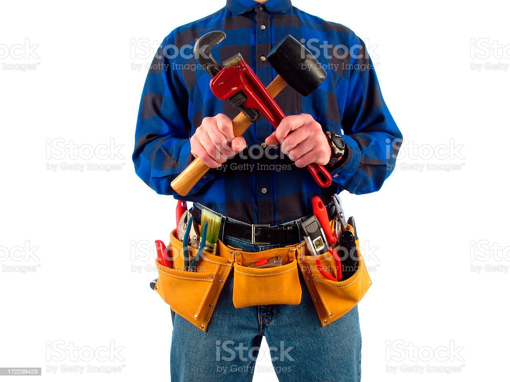 Torso of Handyman with Tool Belt Holding Tools in X-pattern royalty-free stock photo