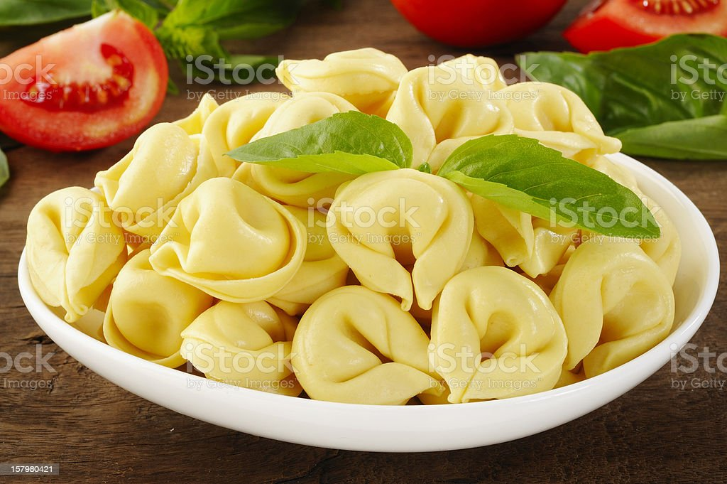 tortellini in white dish stock photo
