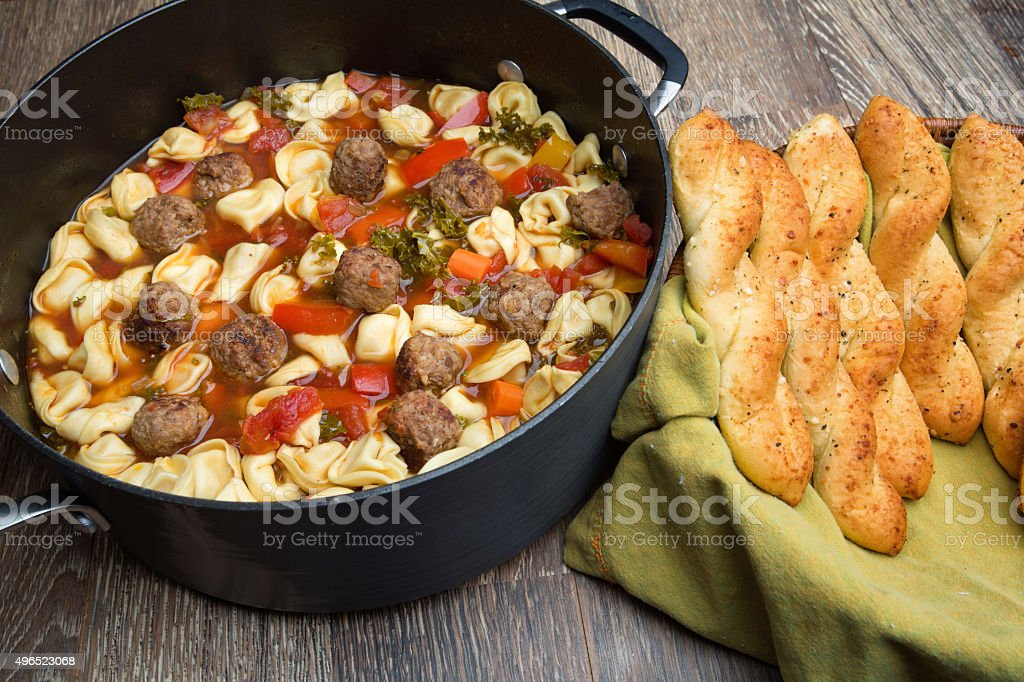 Tortellini Meat Ball Italian Soup and Bread Sticks stock photo