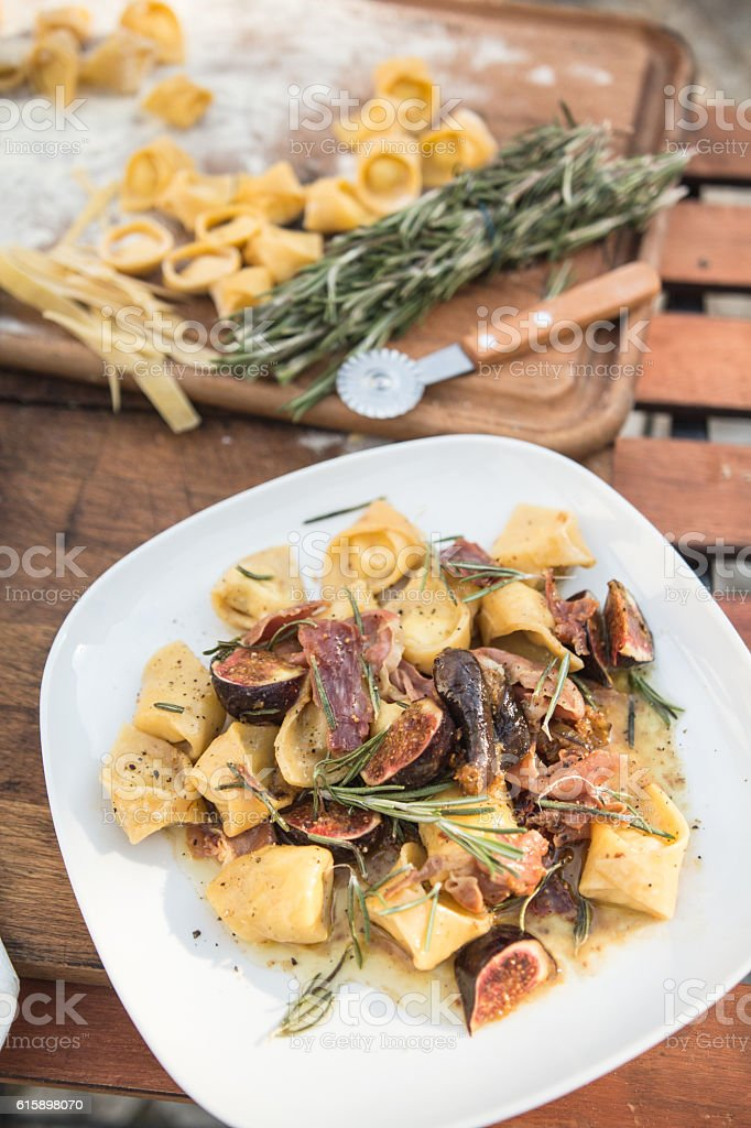 Tortellini with fig and rosemary stock photo
