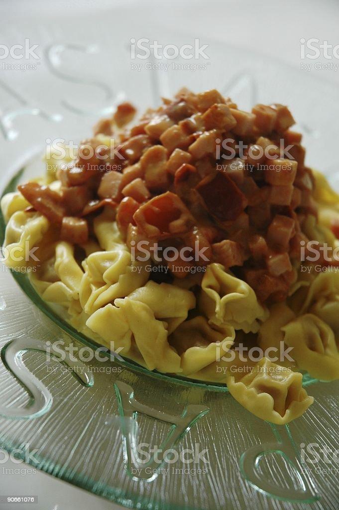 Tortellini with ham sauce stock photo