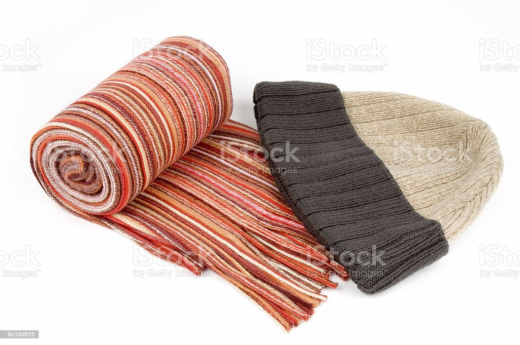 Tortile multicolor wool scarf and cap over white background royalty-free stock photo
