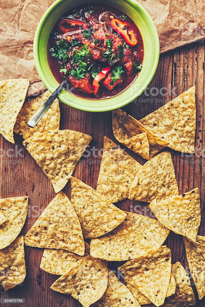 Tortilla chips and mexican salsa stock photo