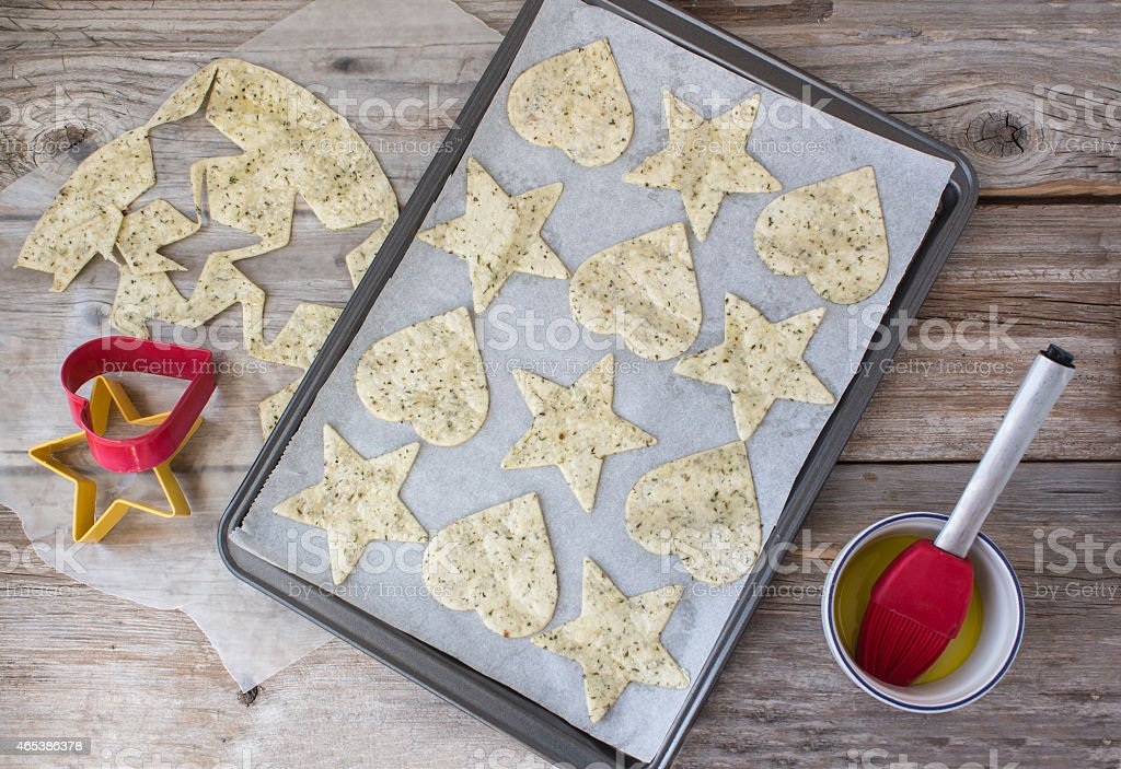 tortilla chips lying in a cookie sheet ready to bake. stock photo