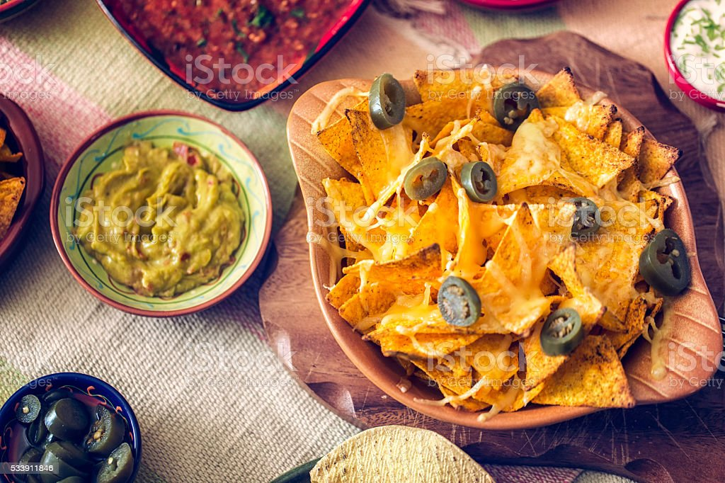 Tortilla Chips with Cheese and Jalapenos stock photo