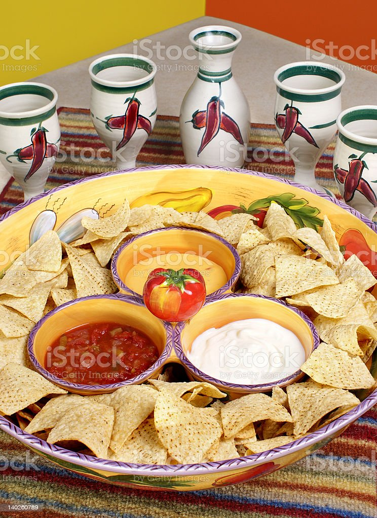 Tortilla chips with dips and cups stock photo