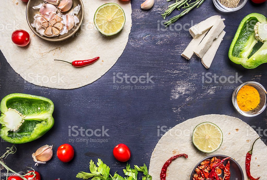 tortilla Ingredients cooking vegetarian burrito  close up  with text area stock photo