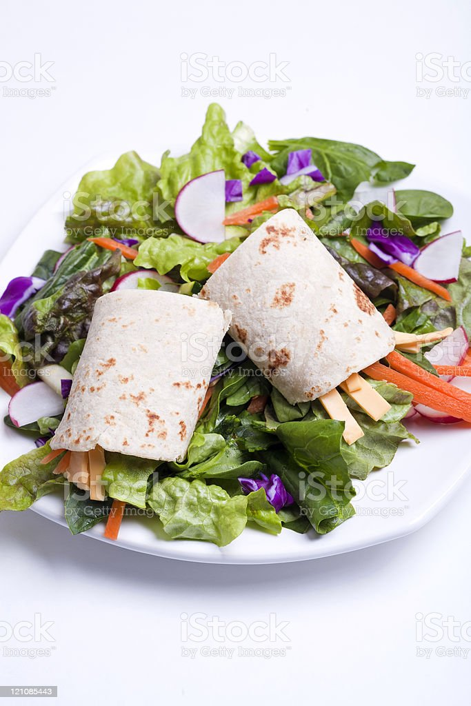 Tortilla wrap on top of salad. royalty-free stock photo