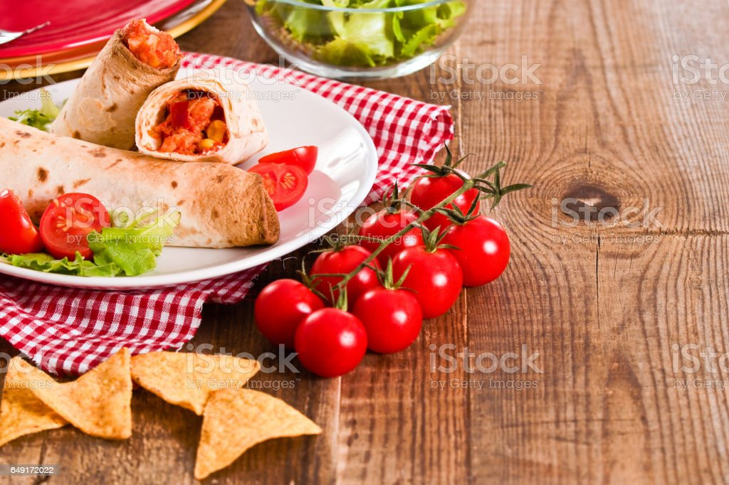 Tortilla wraps with chicken and vegetable. stock photo
