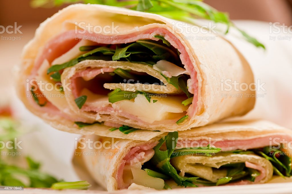 Tortillas with bacon and arugula salad stock photo