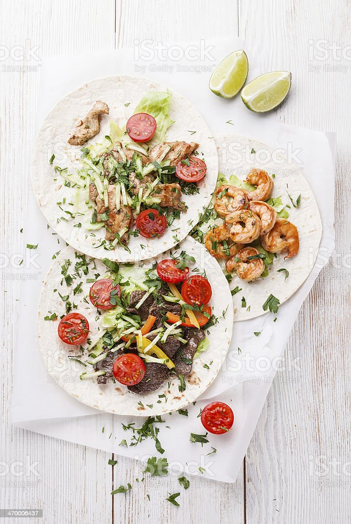 Tortillas with beef, chicken and shrimps stock photo