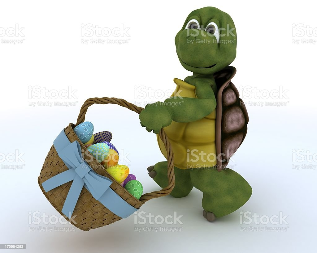 tortoise with basket of easter eggs royalty-free stock photo