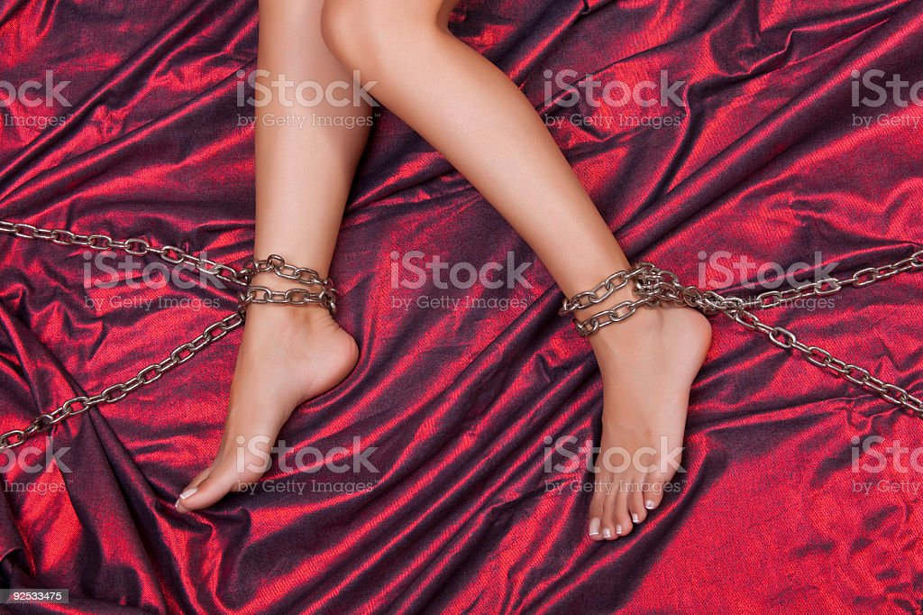 Torture - Chains on legs royalty-free stock photo