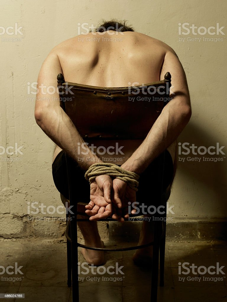 Torture man with tye hands. stock photo