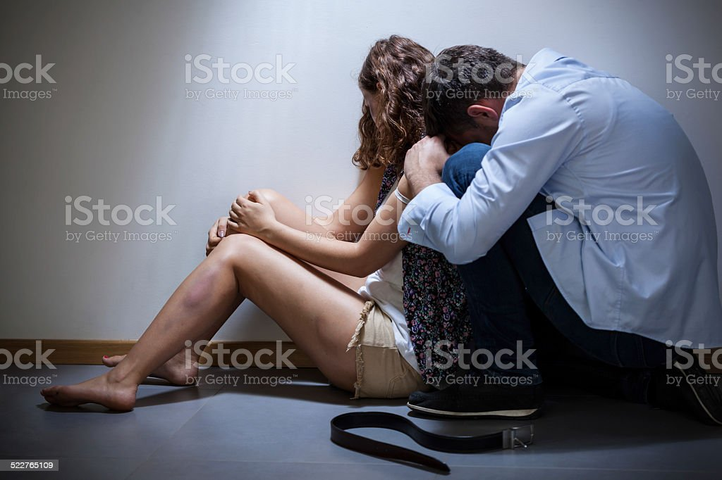 Torturer apologize his wife stock photo