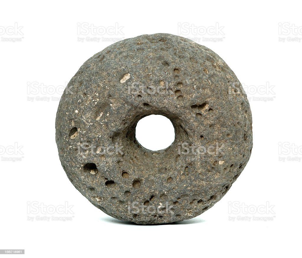 A torus made from porous stone on a white background stock photo