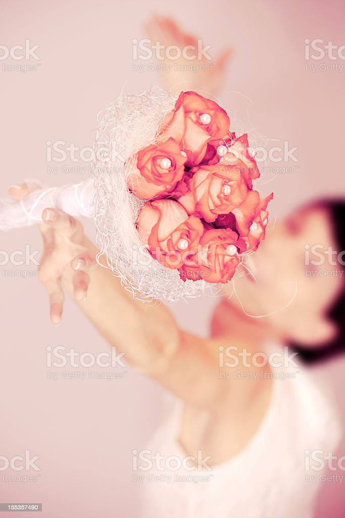 Tossing a bridal bouquet stock photo