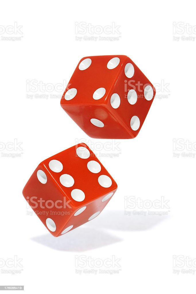 Tossing Red Dice Isolated on White stock photo