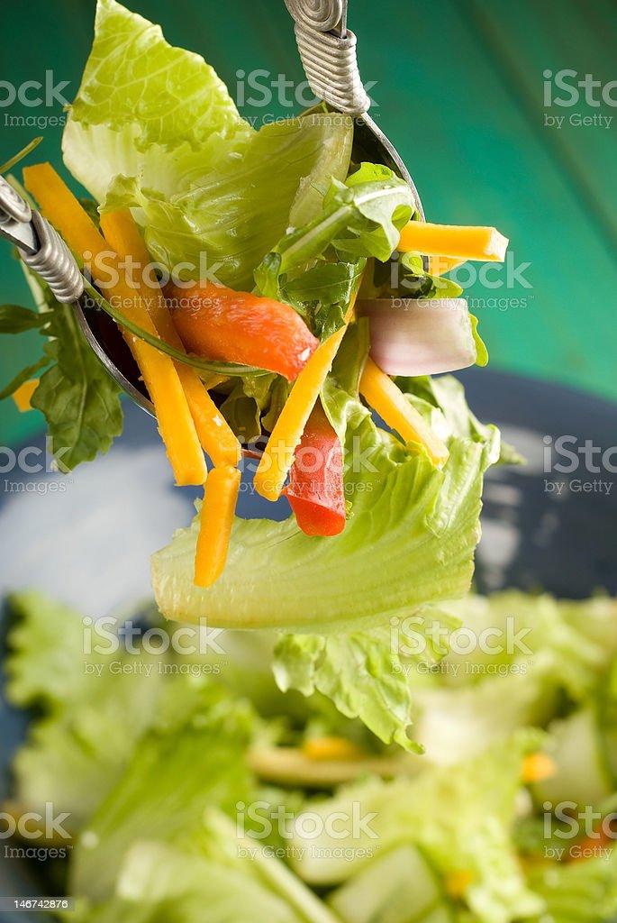 Tossing salad stock photo
