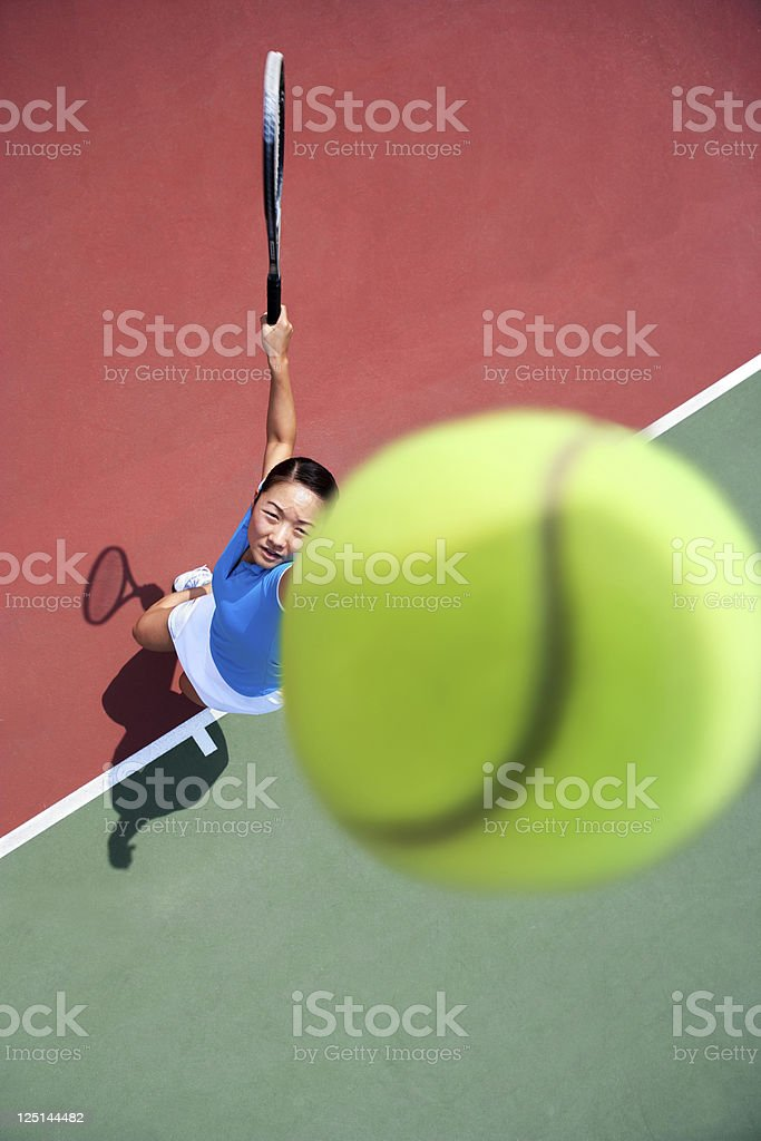Tossing tennis ball and serve royalty-free stock photo
