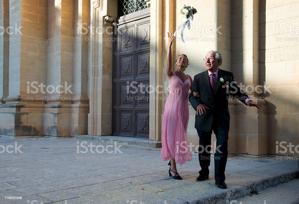 tossing the bouquet royalty-free stock photo