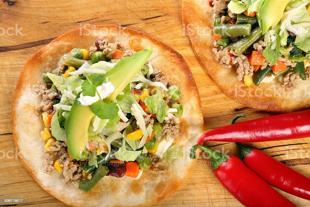 Tostadas with ground beef and vegetables on wooden background stock photo