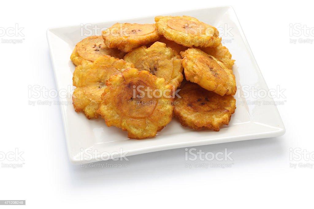 tostones, fried green plantain banana chips stock photo