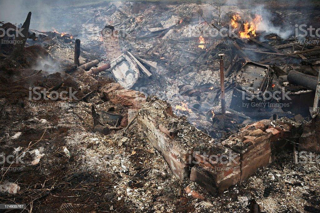 Total devastation, burning house. stock photo
