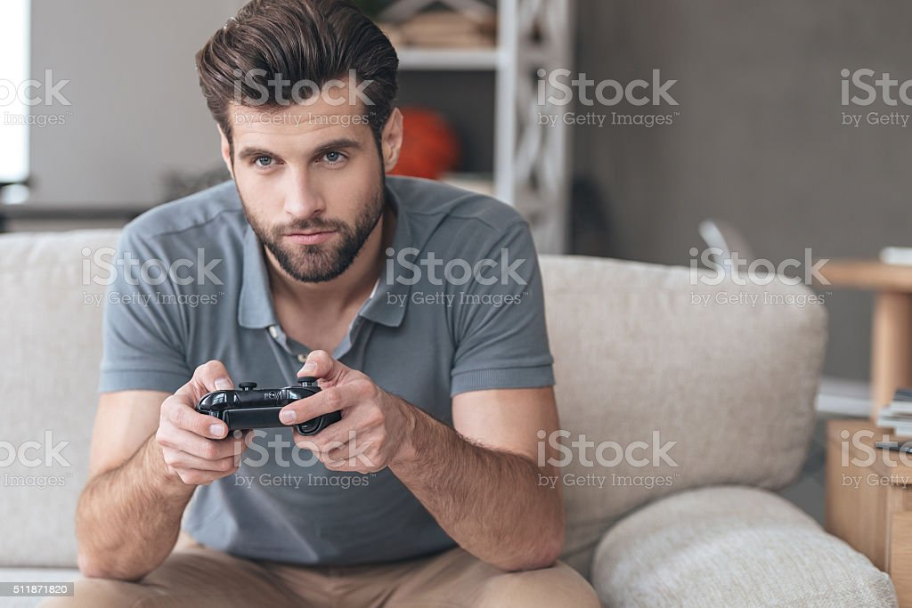 Totally concentrated on his game. stock photo