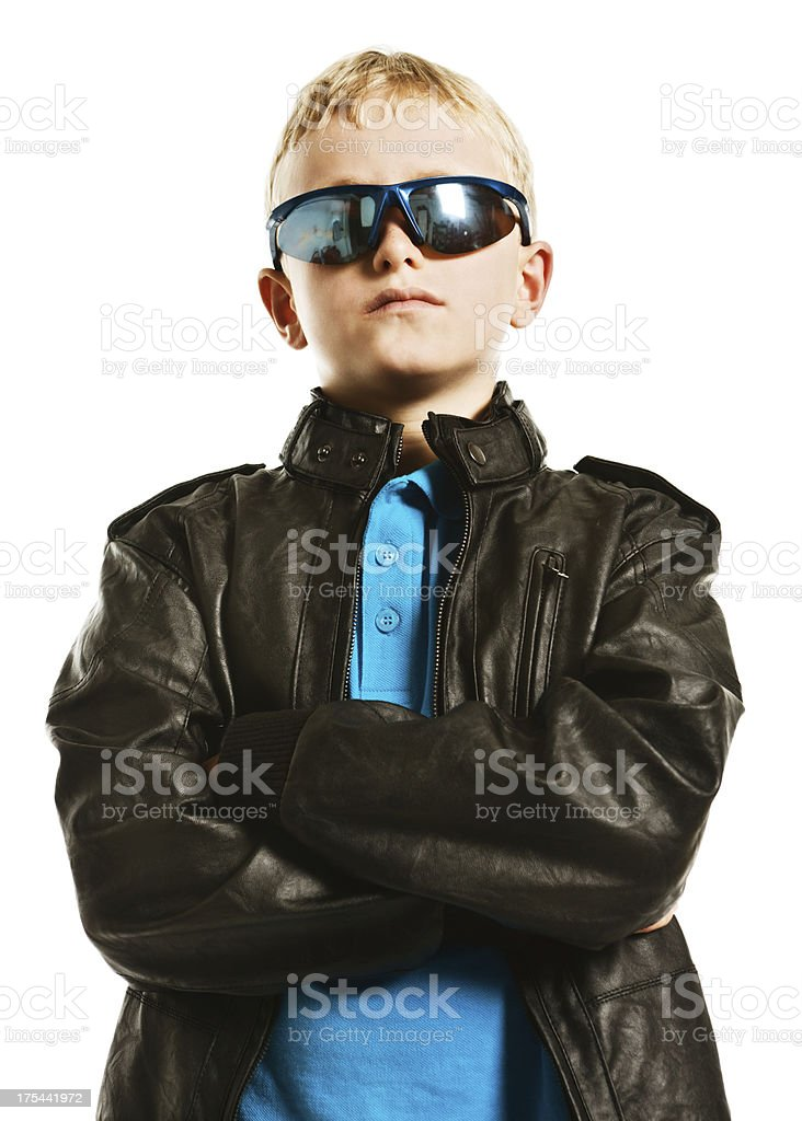 Totally cool pre-teen boy shows plenty of attitude stock photo