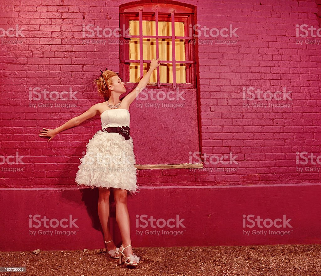 Totally Diva Standing Against A Pink Brick Wall royalty-free stock photo