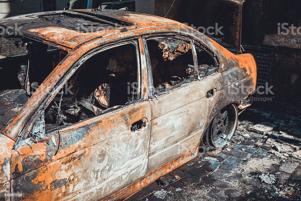 Totally incinerated burnt out luxury sedan stock photo
