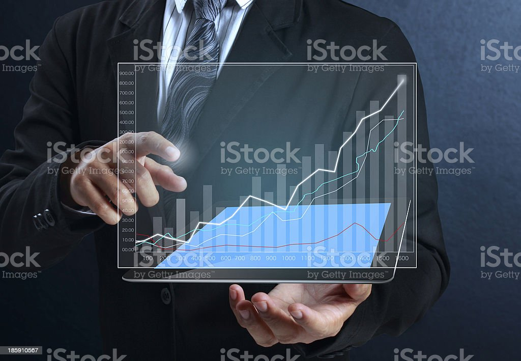 touch screen graph on tablet in hands stock photo