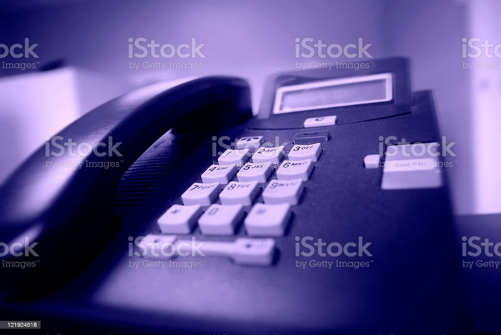 touch tone telephone close up stock photo