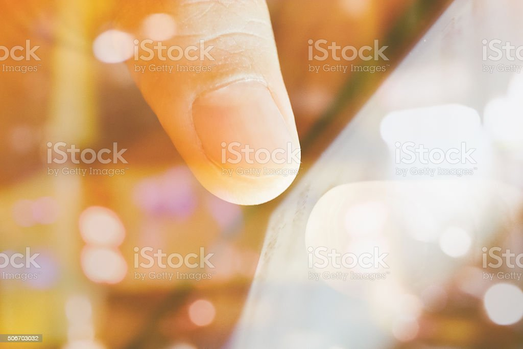 touching a digital tablet stock photo