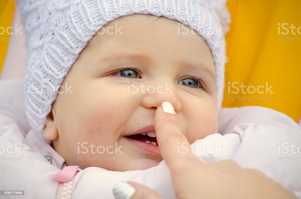 touching baby's nose stock photo