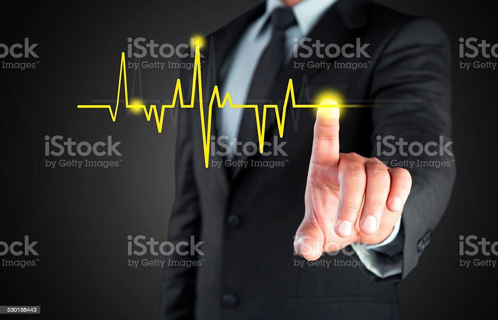 Touching cardiogram stock photo