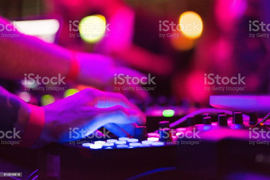 DJ touching dial. stock photo