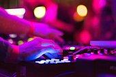 DJ touching dial.