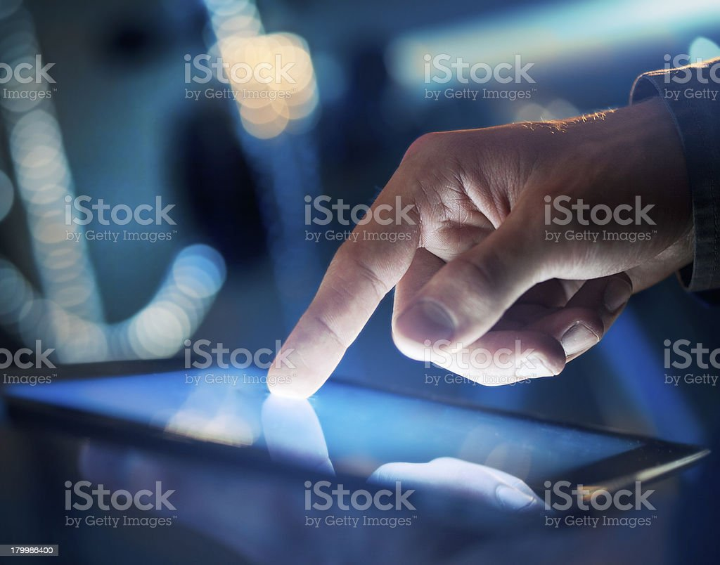 touching digital tablet stock photo