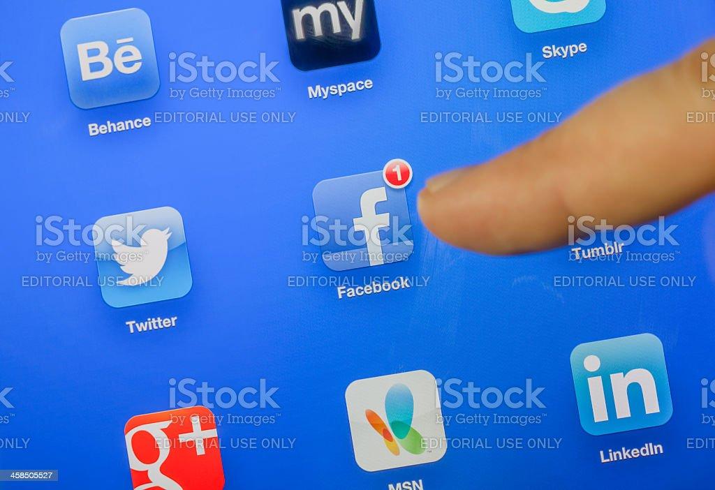 touching facebook icon stock photo